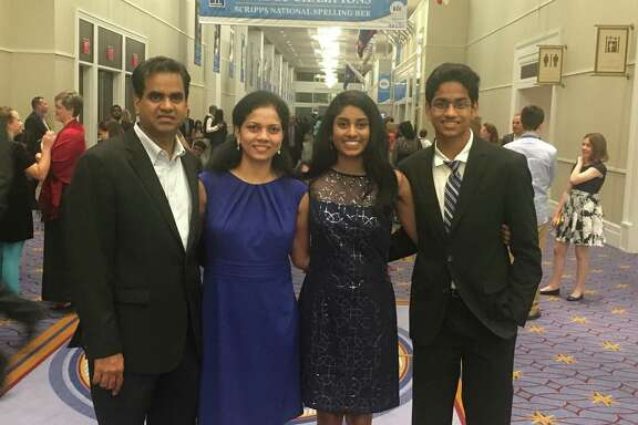 The Dasari family pose for a photo at a Scripps National Spelling Bee. Left to right: Ganesh Dasari, Usha Dasari, Shobha Dasari, Shourav Dasari.