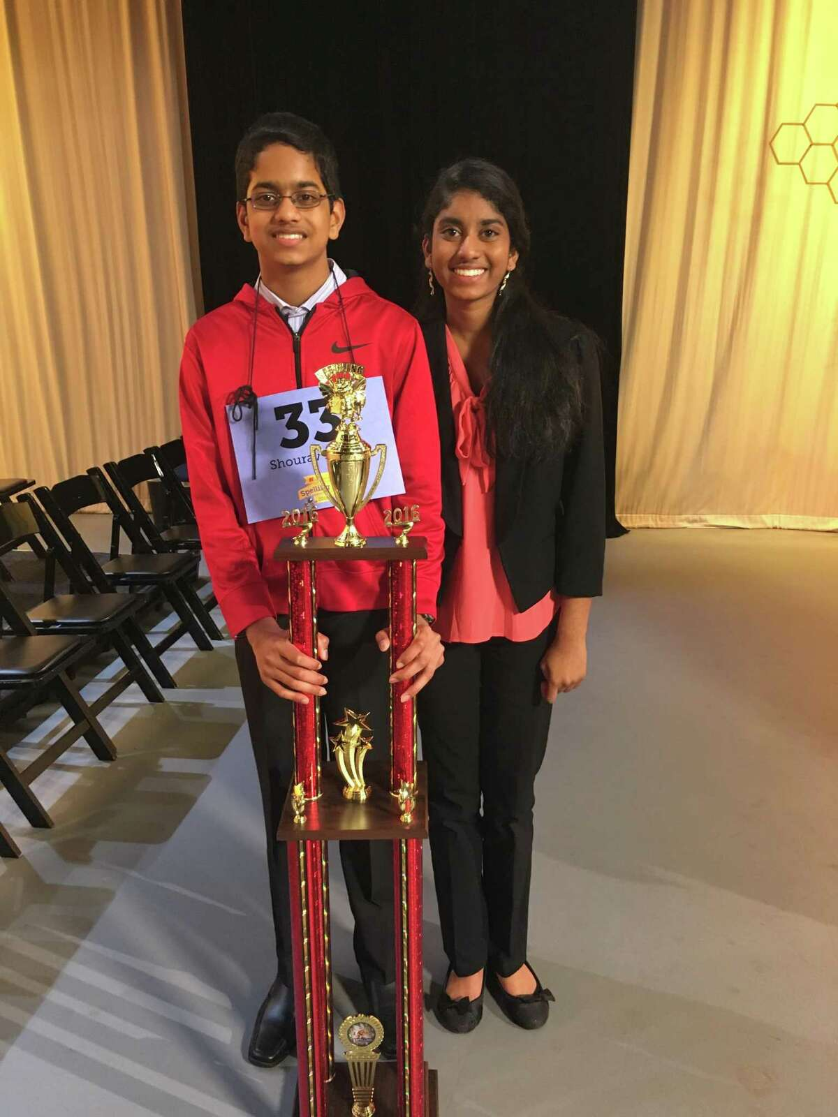 Shourav Dasari and Shobha Dasari take a photo with a trophy at the 2016 Houston Public Media Spelling Bee.