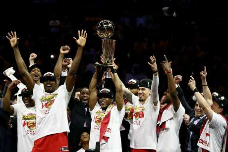 OAKLAND, CALIFORNIA - JUNE 13:  Kawhi Leonard #2 of the Toronto Raptors celebrates with the Larry O'Brien Championship Trophy after his team defeated the Golden State Warriors to win Game Six of the 2019 NBA Finals at ORACLE Arena on June 13, 2019 in Oakland, California. NOTE TO USER: User expressly acknowledges and agrees that, by downloading and or using this photograph, User is consenting to the terms and conditions of the Getty Images License Agreement. (Photo by Ezra Shaw/Getty Images) *** BESTPIX ***