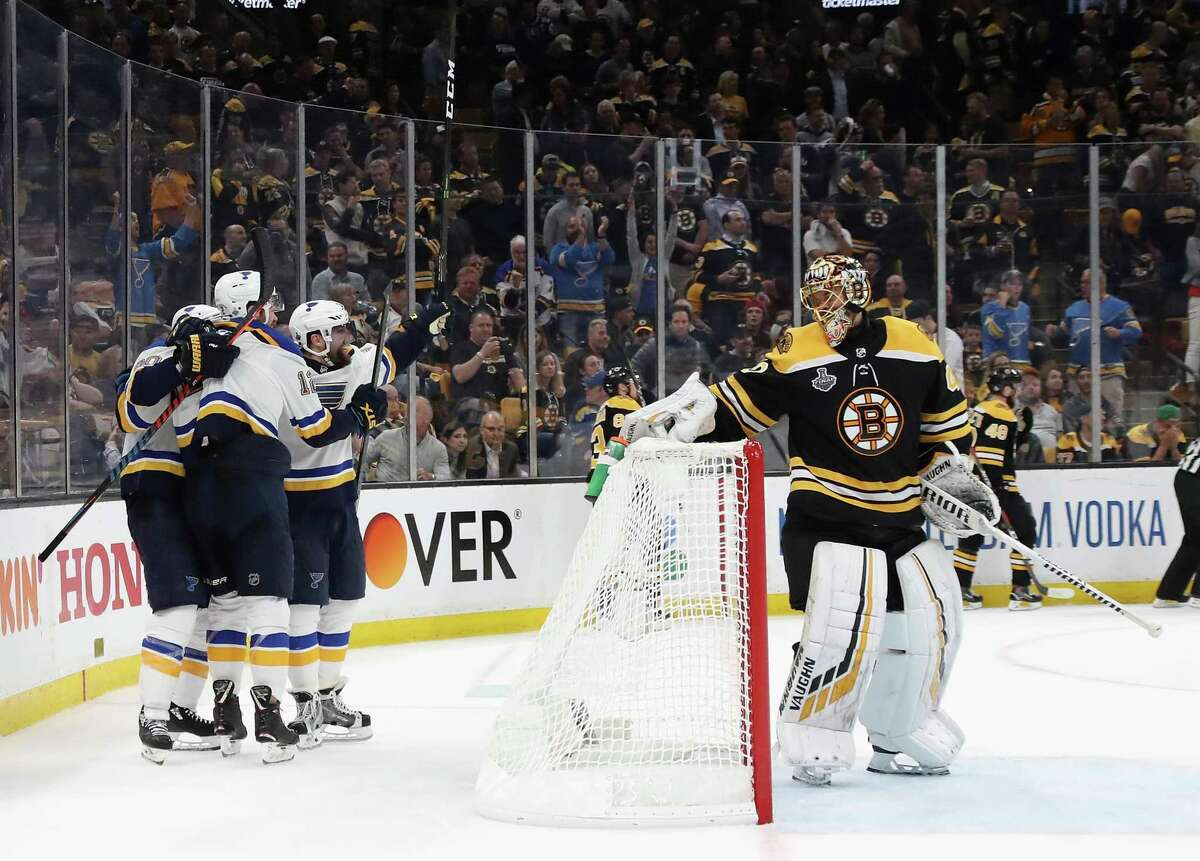 BOSTON, MASSACHUSETTS - JUNE 12: Zach Sanford #12 of the St. Louis Blues is congratulated by his teammates after scoring a third period goal as Tuukka Rask #40 of the Boston Bruins reacts in Game Seven of the 2019 NHL Stanley Cup Final at TD Garden on June 12, 2019 in Boston, Massachusetts. (Photo by Bruce Bennett/Getty Images) ***BESTPIX***