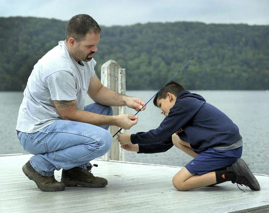 Frank Allo of Danbury, and son Frankie, 10, spend time together fishing off the dock at Candlewood Park in Danbury, Monday, Oct. 1, 2018, Photo: Carol Kaliff / Hearst Connecticut Media / The News-Times