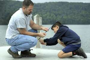 Frank Allo of Danbury, and son Frankie, 10, spend time together fishing off the dock at Candlewood Park in Danbury, Monday, Oct. 1, 2018,