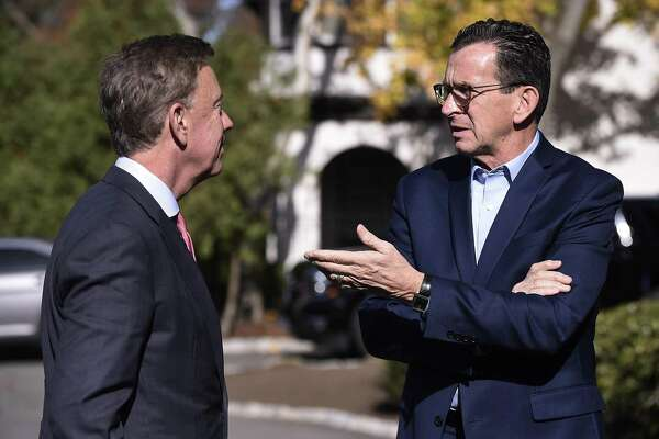 Gov. Ned Lamont (left) with his predecessor Dannel P. Malloy in November 2018 in Hartford, Conn. (AP Photo/Jessica Hill)