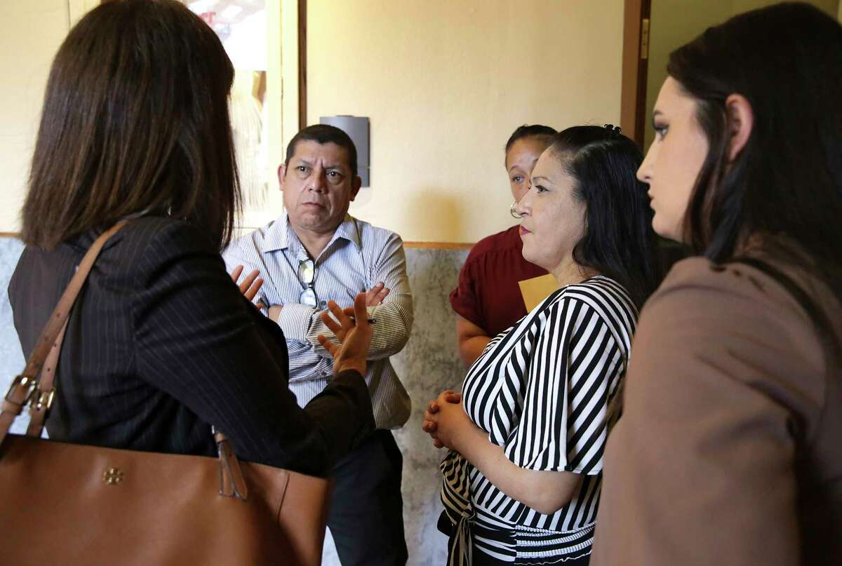 Lawyer Christine Hortick, left, speaks to Fernando Yee, from left, step grandfather of King Jay Davila, Denisse Santana, Maria Josephine Morales King Jay's grandmother, and Jasmine McGill, right, following a status hearing in Children's Court before Judge Richard Garcia on Friday, June 14, 2019, in the Bexar County Courthouse.