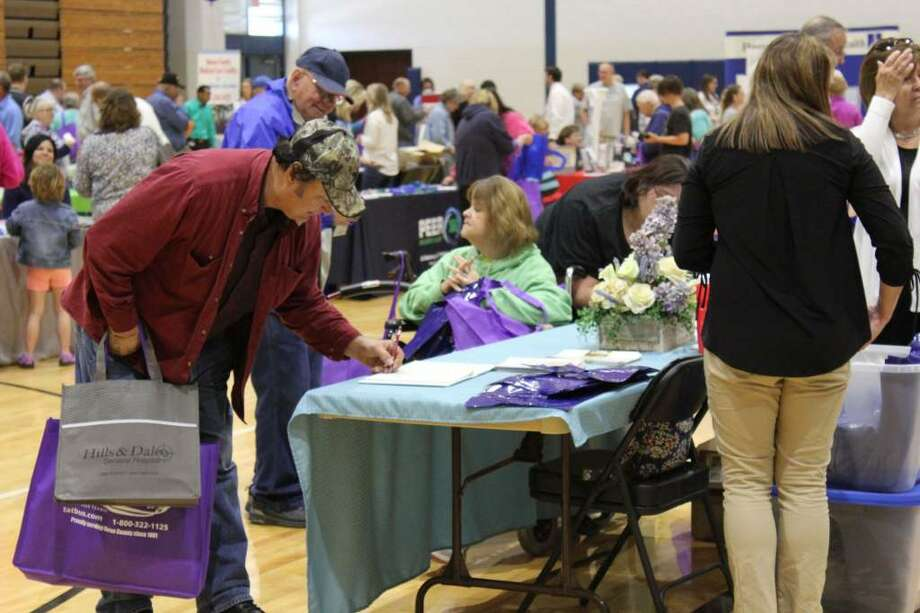 Huron County seniors came in droves to the Huron County Senior Fair at Bad Axe High School on Friday. Attendees could visit booths for various senior services and attend seminars. (Robert Creenan/Huron Daily Tribune)