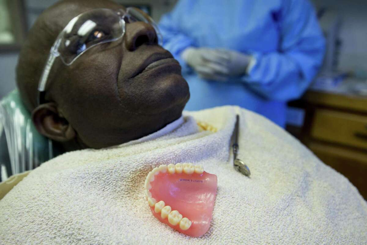 Bezaley Jackson sits in the dental chair as he is fitted for new 3D printed dentures at the Goree Unit 3D Denture Clinic on Thursday, June 13, 2019, in Huntsville.