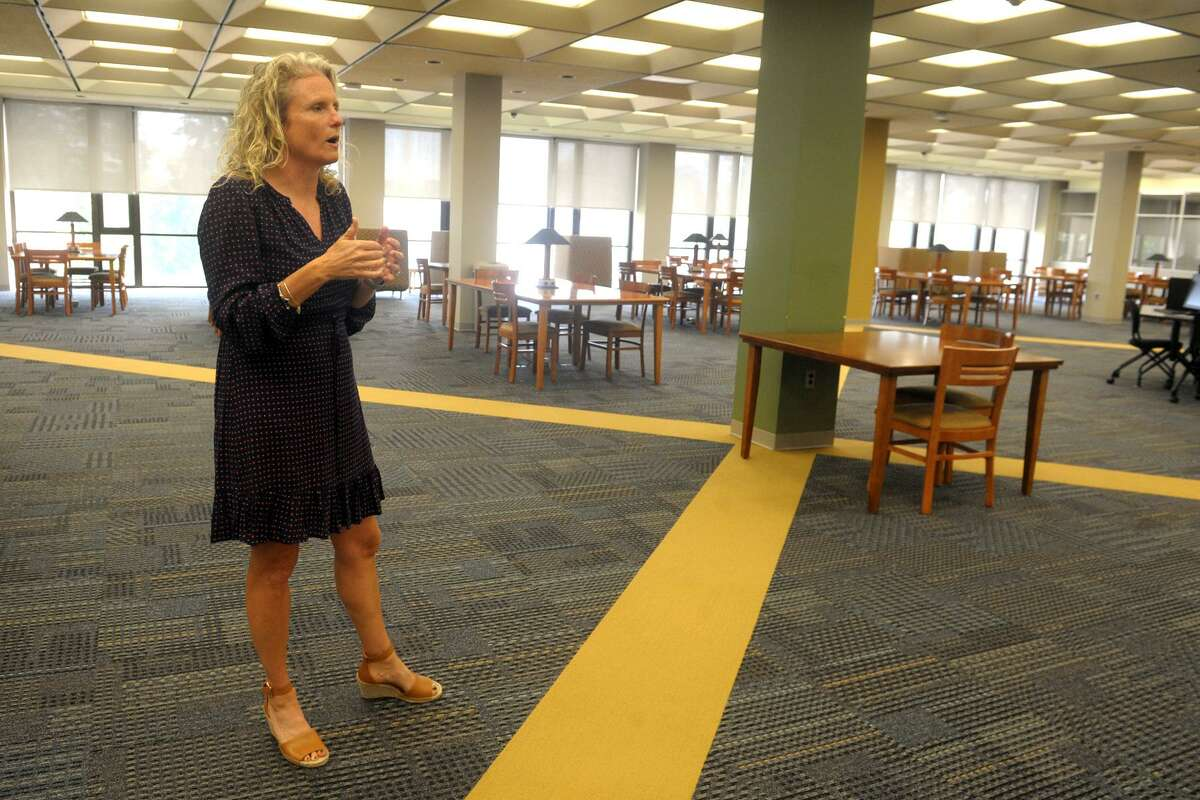 Sara Connolly, an assistant provost, speaks on the second floor of the Walhstrom Library at the University of Bridgeport, in Bridgeport, Conn. June 12, 2019. The floor will soon be converted into the Heckman Center for the Bridgeport Plan.