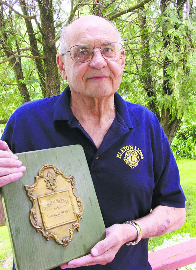 Donald Weiss displays his Boy Scout of the Year award. (Rich Harp/For the Tribune)