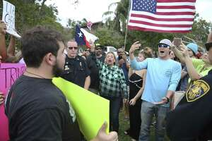 Matthew Springer (center right) banters with anti-Trump demonstrators as supporters of President Donald Trump clash with a handful of protesters across from the Annaville Fire Department where the President met with local officials dealing with the effects of Hurricane Harvey on August 29, 2017. Civility is important.