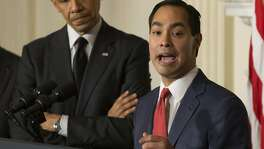 San Antonio Mayor Julian Castro speaks as President Barack Obama looks on during an announcement in the State Dining Room of the White House, in Washington, May 23, 2014. Obama announced Castro as his nominee to replace Housing and Urban Development Secretary Shaun Donovan Friday, and nominated Donovan to take the place as the chief of the White House budget office. (Doug Mills/The New York Times)