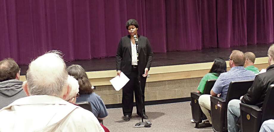 Vanessa Day, a representative Myers and Stauffer, explains consultants were at the forum only to listen. Photo: Mary Drier/For The Tribune / Copyright 2012