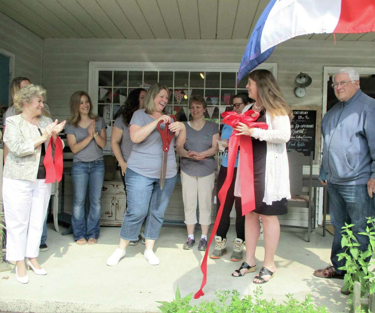 Charlotte Adams and her staff were joined by Woodbury First Selectman Barbara Perkinson, left, and Chamber of Commerce members President Karen Reddington-Hughes and Paul Luchetti, far right, for the ribbon-cutting ceremony.