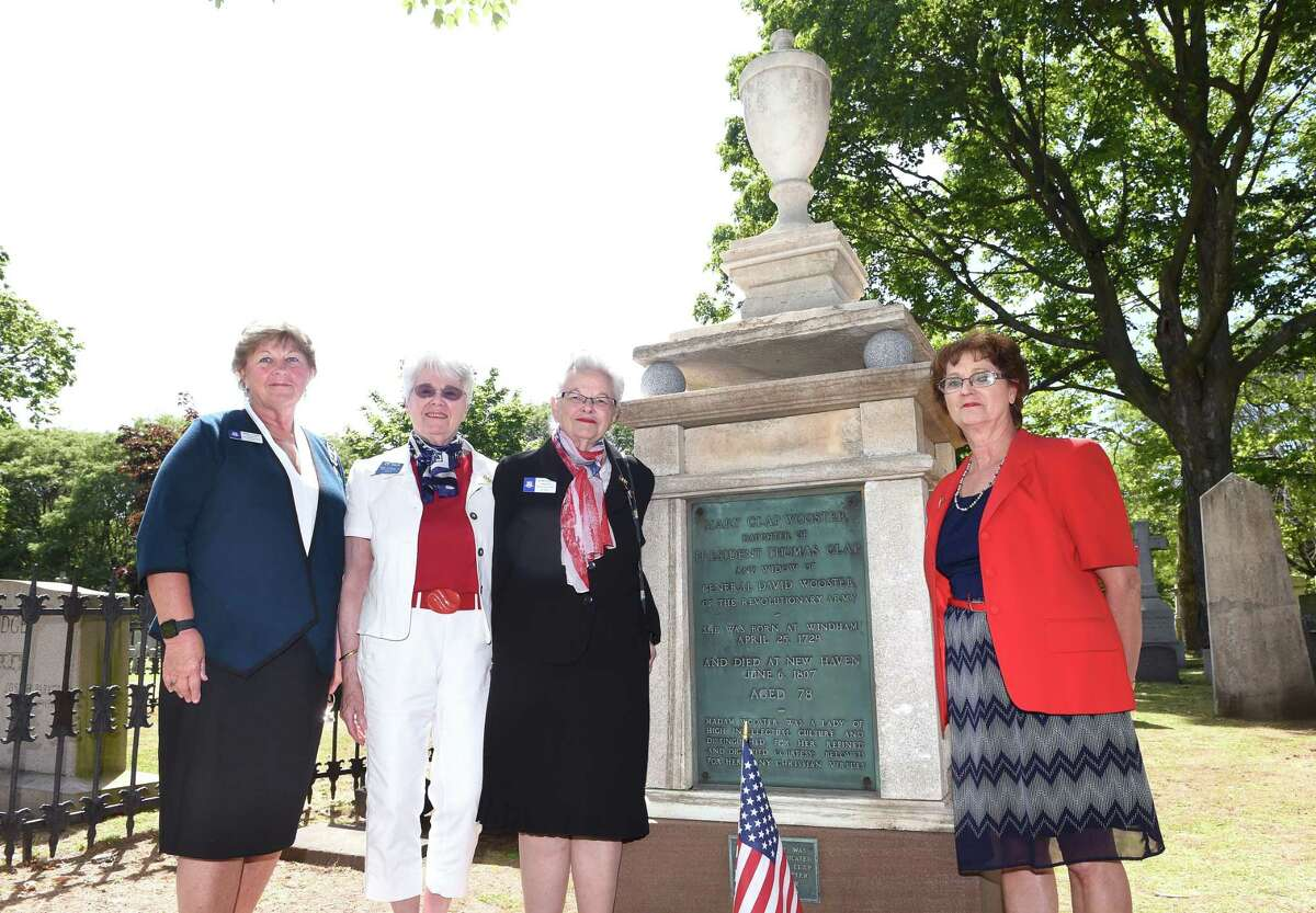 From left, Sandra Nuhn, Tina Vermette, Sandra Lynch and Judy Arnold of the Mary Clap Wooster Chapter of the Daughters of the American Revolution are photographed by Mary Clap Wooster's grave at the Grove Street Cemetery in New Haven June 12, 2019. The monument will be rededicated June 22.