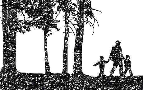 Father and his two kids walking on a trail in the forest and holding hands
