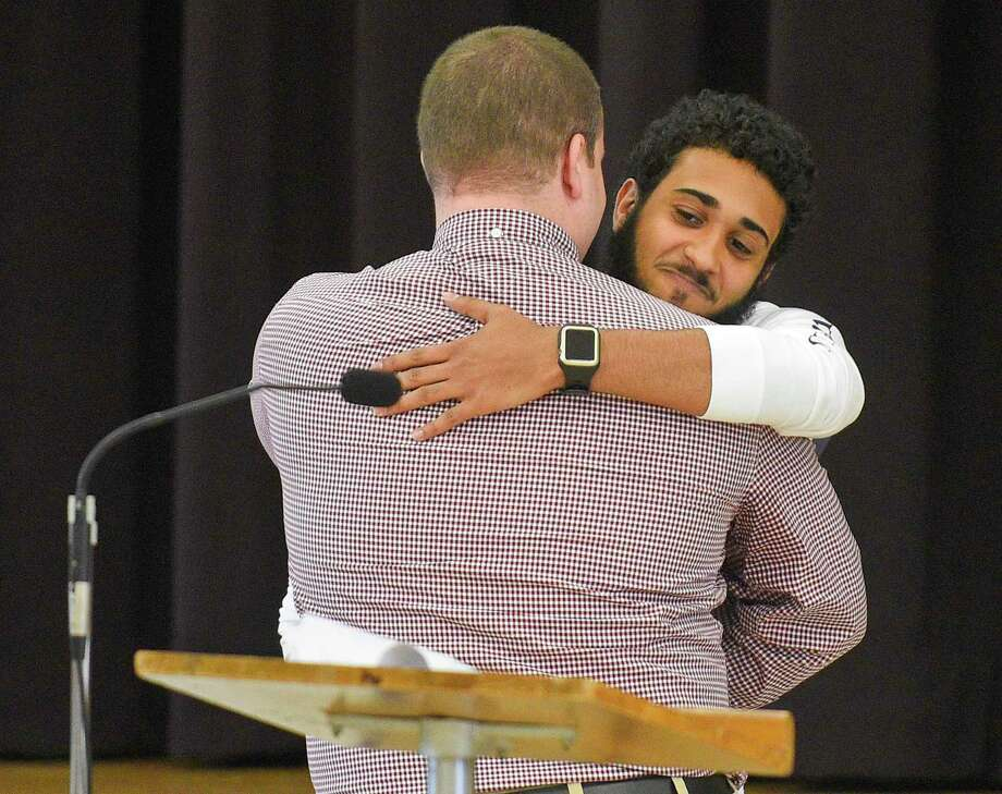 Terrell Magliulo hugs teacher Richard Kahn following his remarks about Magliulo. The students of Windrose, Greenwich High's alternative high school, are recognized and celebrated for their accomplishments in completing their graduation requirements. Thirteen students received certificates in a ceremony at St. Catherine Church on June 14, 2019 in Greenwich, Connecticut. Photo: Matthew Brown / Hearst Connecticut Media / Stamford Advocate