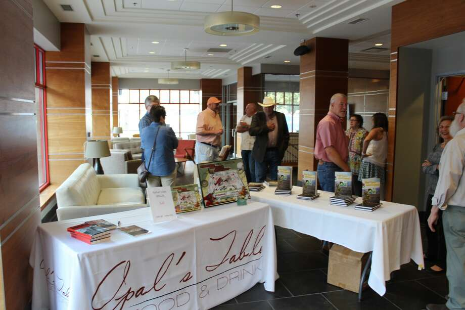 Opal's Table hosted Wine and Words Dinner on June 12 to benefit the Permian Basin Bookies. The four-course meal was based on literary works and paired with various wine labels. The event also featured local authors and their books. Photo: Rich Lopez/MRT