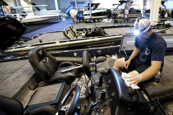 Gatlin Stringer shines up a bass boat while preparing for the opening of the Houston Summer Boat Shows at NRG Center on Tuesday, June 11, 2019, in Houston. The show runs June 12-16.