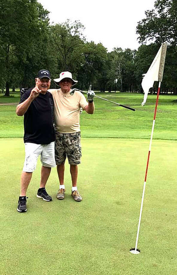 Bud Vallino, left, and Harold Patton pose for a photo on June 8 at Oak Brook Golf Club after scoring consecutive hole-in-ones on the 142-yard, par-3 hole No. 22. Photo: For The Intelligencer