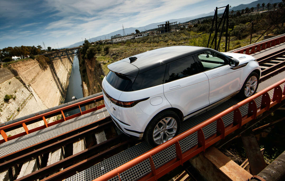 New meets old: Range Rover secured permission to drive the second-generation Evoque on a railroad trestle some 300 feet above the 70-foot-wide Corinth Canal. First opened 126 years ago, the four-mile long waterway cleaves the Isthmus of Corinth, separating the Peloponnese from the Greek mainland.