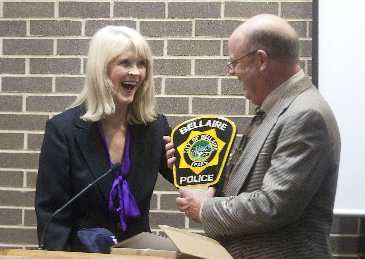 Bellaire's Chief of Police Randall Mack presents outgoing Mayor Cindy Siegel with a plaque during her final city council meeting in July 2017.