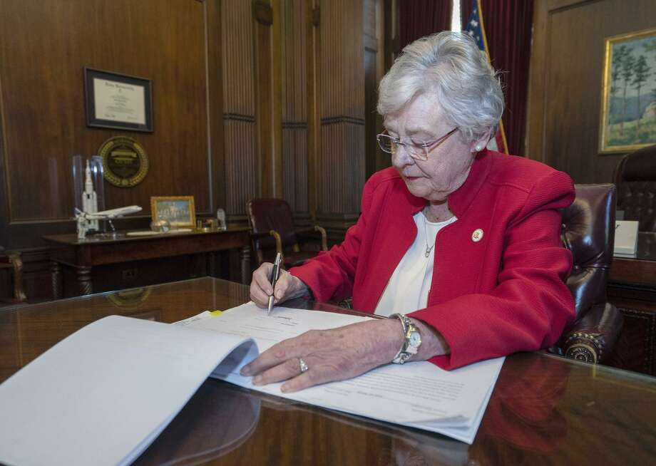 Gov. Kay Ivey signs Alabama's harsh anti-abortion bill. The state also chose not to end parental rights in cases of rape that result in conception. Photo: Alabama Governor's Office / Alabama Governor's Office