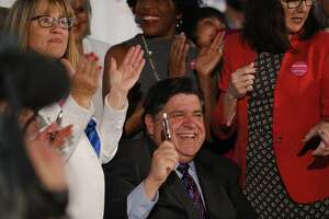 Illinois Gov. J.B. Pritzker signs the Reproductive Health Act into law June 12. The abortion debate has become red hot with even corporate CEOs signing on to the procedure as a fundamental right, what the Illinois law does.
