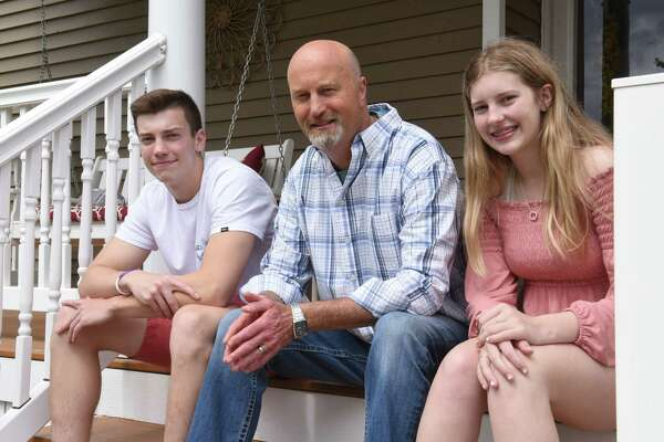 Jeff Malo sits in front of his home with his son Bailey, 17, and daughter Faith, 15, on Friday, June 14, 2019 in Loudonville, N.Y. Jeff's father James Malo, Sr. donated a kidney to him back in 1990. (Lori Van Buren/Times Union)