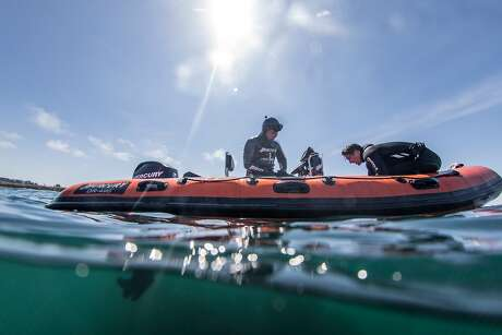 Greg Fonts, left, gets back on his boat after spearfishing and free diving for shell fish off the north coast of California near Fort Bragg on Sunday, May 12, 2019. Photo: Brian Feulner / Special To The Chronicle