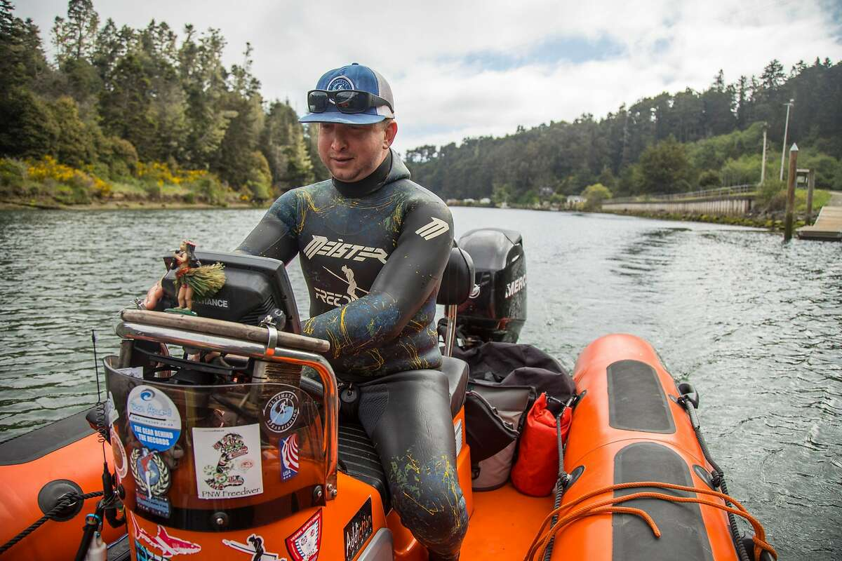 Greg Fonts drives his small boat out of the Noyo Harbor to go spearfishing and freedivingoff the north coast of California near Fort Bragg on Sunday, May 12, 2019.