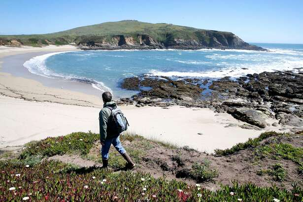 Marine biologist Eric Sanford hikes down to Horseshoe Cove to study tide pools at the UC Davis Bodega Marine Laboratory in Bodega Bay, Calif. on Wednesday, April 17, 2019. Sanford's research is examining the impacts that climate change is having within intertidal zones.