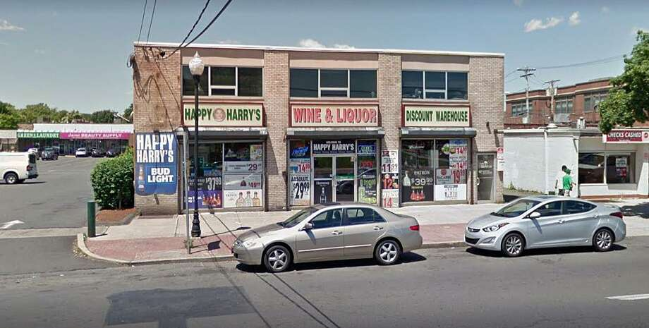 Happy Harry's Wine and Liquor at 956 Dixwell Ave. in Hamden, Conn., seen in this Google streetview screenshot. The establishment was recently referred to the Liquor Control Division after selling alcohol to a someone under the age of 21. Photo: Contributed Photo / Google Streetview
