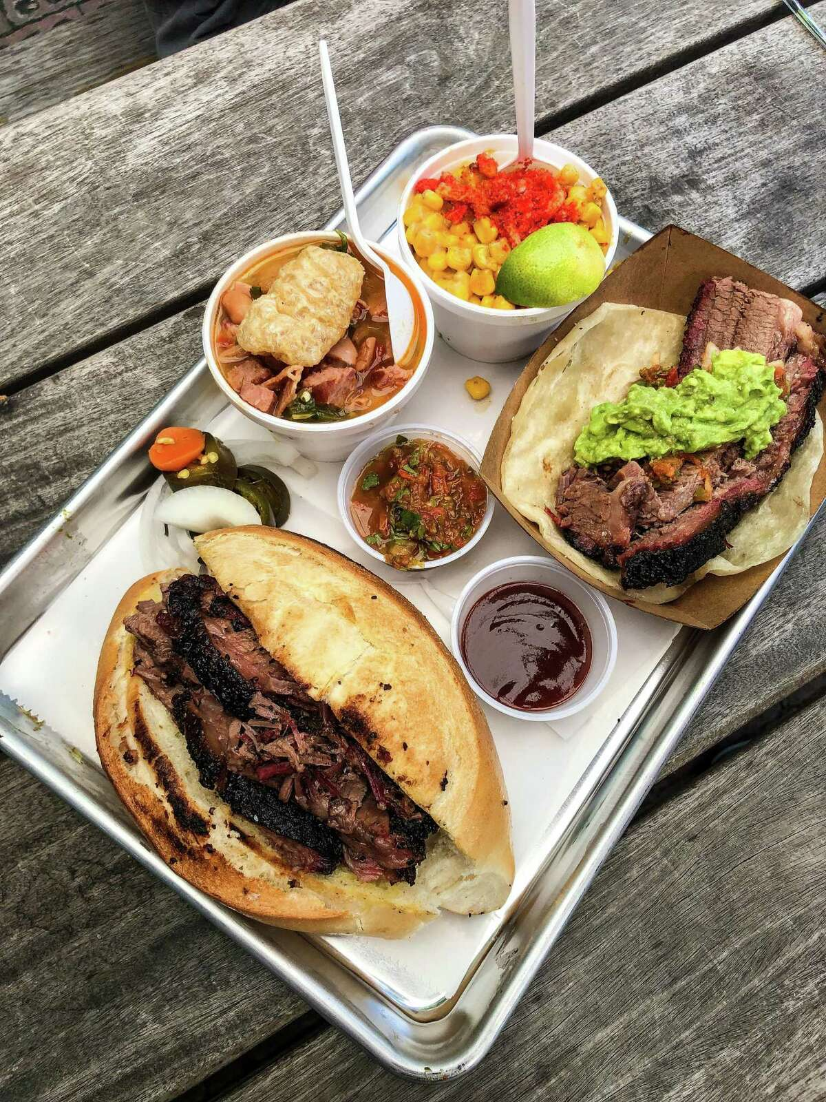 Tex-Mex barbecue plate with brisket bolillo, brisket taco, charro beans and elotes at Eddie O's Texas Barbecue pop-up at D&T Drive Inn.