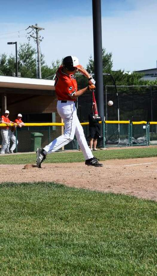 Edwardsville's Evan Funkhouser puts a swing on a pitch during Friday's game against the St. Louis Drillers in tournament play at Tom Pile Field. Photo: Tyler Pletsch | The Intelligencer