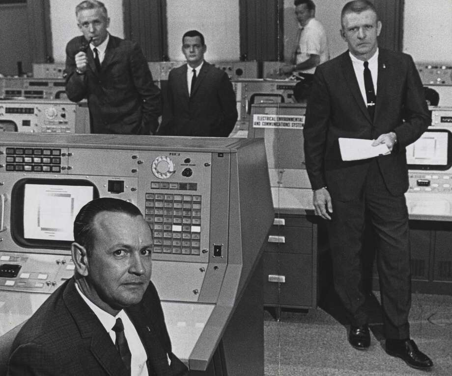 This June 1965 shows Christopher Kraft, foreground, flight director at what was then the Manned Spacecraft Center in Houston, with (from left) John D. Hodge, chief of the flight control division; Glynn Lunney, flight director at Cape Kennedy during launch phase only; and Gene Kranz, who relieved Kraft at the post. Photo: Ted Rozumalski, Staff / Houston Chronicle File Photo / Houston Chronicle