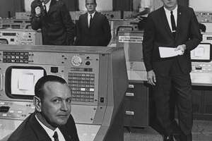 This June 1965 shows Christopher Kraft, foreground, flight director at what was then the Manned Spacecraft Center in Houston, with (from left) John D. Hodge, chief of the flight control division; Glynn Lunney, flight director at Cape Kennedy during launch phase only; and Gene Kranz, who relieved Kraft at the post.