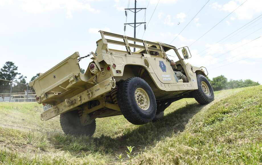 Pinehurst police officer Josh Lockett drives a humvee through a ditch during Pinehurst Police Department's HMMWV familiarization training which involved driving the HMMWV over various obstacles Friday afternoon. Photo taken on 06/14/19. Ryan Welch/The Enterprise Photo: Ryan Welch/The Enterprise