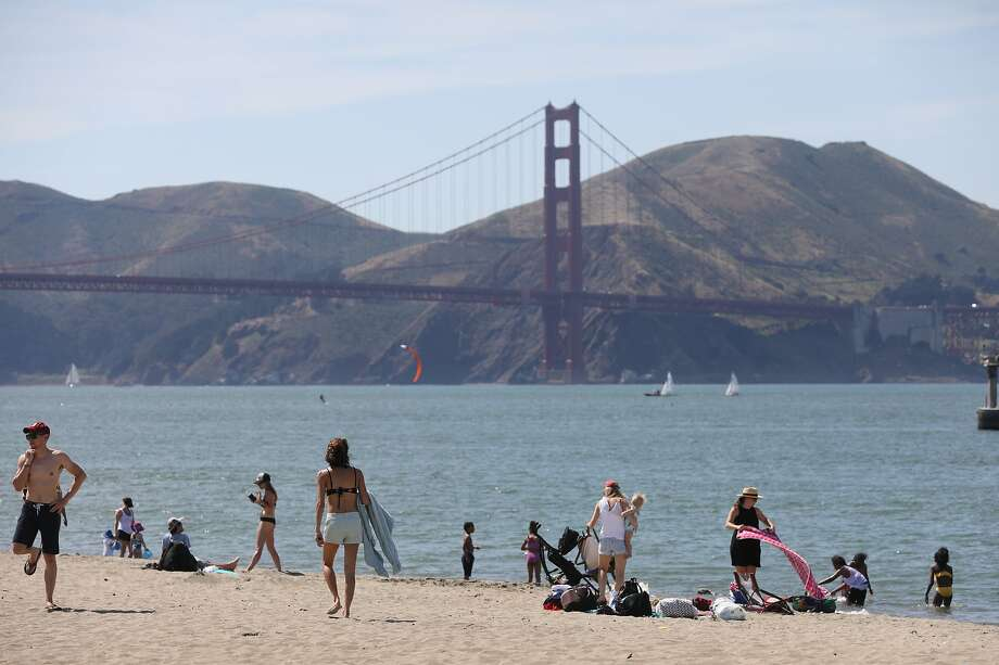 Crissy Field beach attracts visitors Monday, when the city hit a high of 97. Photo: Lea Suzuki / The Chronicle
