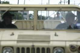 Lt. Comm. Danny Hammond with the US Navy Reserves helps Pinehurst firefighter Mike Wiley back up during Pinehurst Police Department's HMMWV familiarization training which involved driving the HMMWV over various obstacles Friday afternoon. Photo taken on 06/14/19. Ryan Welch/The Enterprise
