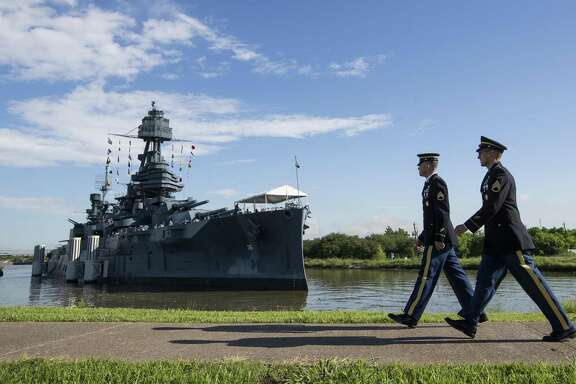 Army Staff Sgt. Jacob Klein, left, and Staff Sgt. Joel Ocasio arrive to the Battleship Texas to participate in a ceremony commemorating the 75th anniversary of D-Day on Thursday, June 6, 2019, in La Porte. The U.S.S. Texas was part of the D-Day operations in Normandy and is the last remaining battleship to have served during the invasion.