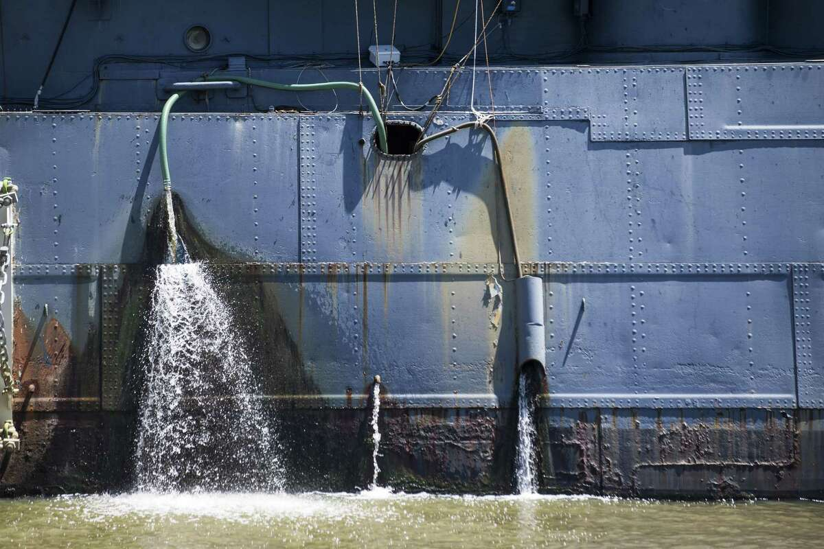 Water is pumped out of the hull of the Battleship Texas on Thursday, June 6, 2019, in La Porte. The U.S.S. Texas was part of the D-Day operations in Normandy and is the last remaining battleship to have served during the invasion. She also served during World War I.