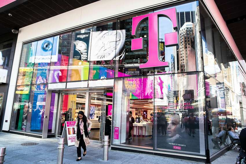 A T-Mobile store in New York, June 11, 2019. A group of attorneys general from nine states and the District of Columbia filed a federal lawsuit on Tuesday in a bid to block a proposed merger between the wireless carriers T-Mobile and Sprint, a $26 billion deal that has yet to receive the Justice Department's approval. (Brittainy Newman/The New York Times)