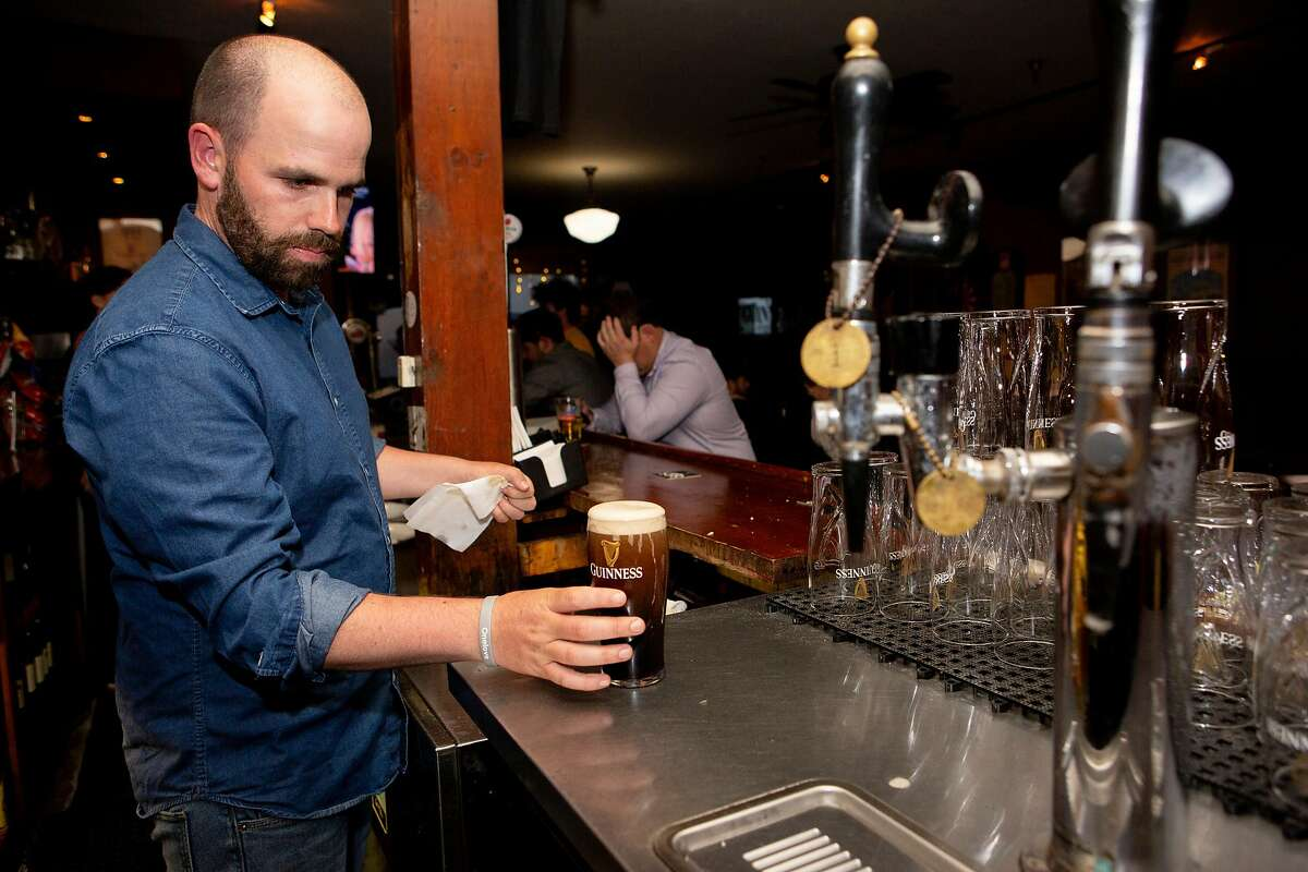 Eoin Malone Hobden prepares a Guinness at the Plough and the Stars Wednesday, June 5, 2019, in San Francisco, Calif. The Irish pub is located at 116 Clement St.
