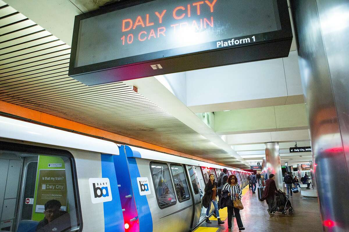People get off the new BART train at the Powell Street Station that's heading toward Daly City on Wednesday, Oct. 24, 2018, in San Francisco, Calif. After many delays, BART has begun running its new trains on complete routes from the East Bay to stations in San Francisco and Daly City.