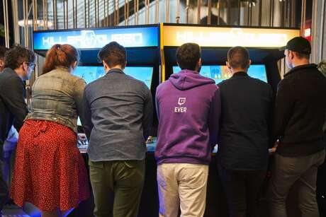 Employees play an arcade game inside Twitch's San Francisco offices. Photo: Avery Wong, Photo By Avery Wong / Courtesy Of Twitch