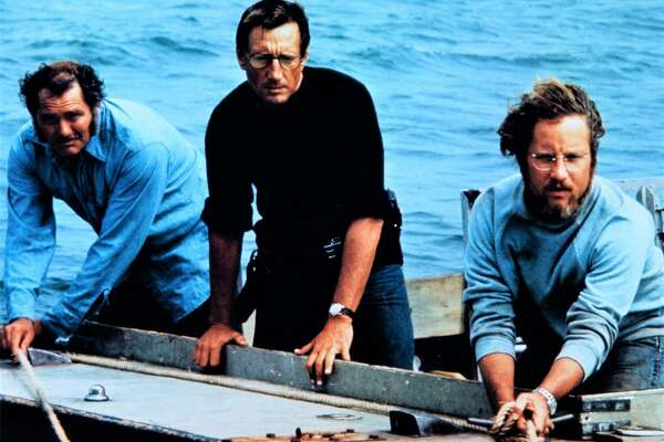 "Robert Shaw, left, Roy Scheider and Richard Dreyfuss in a scene from ""Jaws,"" which Stamford's Avon Theatre is screening July 3."
