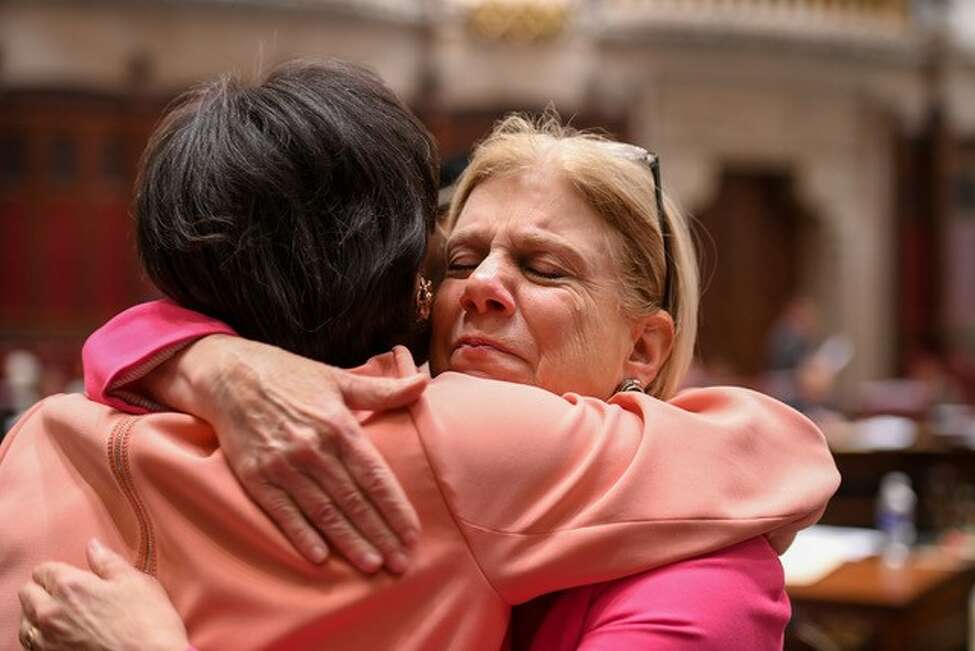 Sen. Shelley Mayer, a Westchester County Democrat, hugs Senate Majority Leader Andrea Stewart-Cousins following the passage of comprehensive rent regulation legislation.
