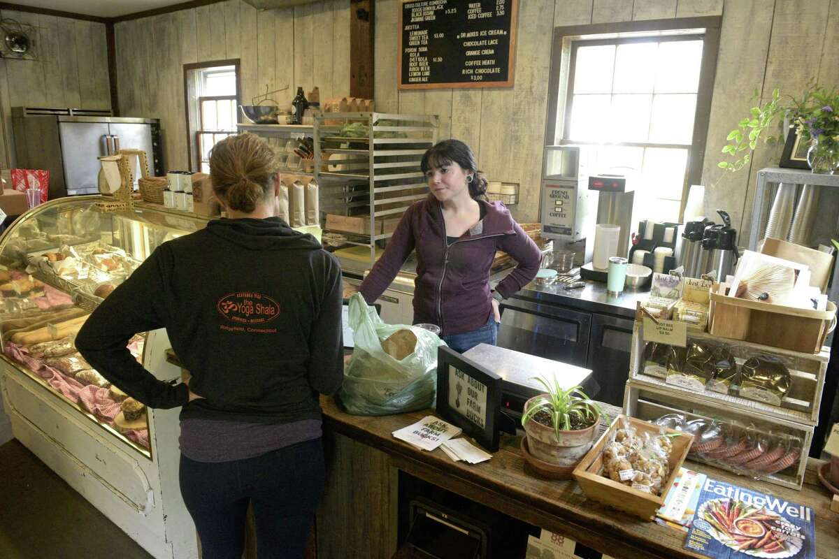 Kristen Apellaniz, right, helps Susan Runge, of Redding at Holbrook Farm in Bethel. Friday, June 14, 2019, in Bethel, Conn. The owners of Taproot restaurant in Bethel and Redding Roadhouse are leasing the farm.