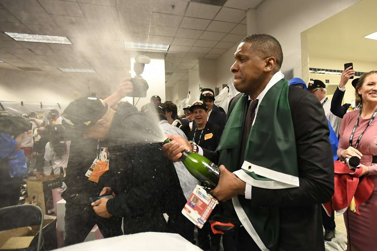 FILE - In this June 13, 2019, file photo, Toronto Raptors President Masai Ujiri celebrates after the team's 114-110 win over the Golden State Warriors in Game 6 of basketball's NBA Finals in Oakland, Calif. Authorities say they are investigating whether Toronto Raptors president Masai Ujiri pushed and hit a sheriff's deputy in the face as he tried to get on the court after his team won the NBA title in Oakland. (Frank Gunn/The Canadian Press via AP, File)