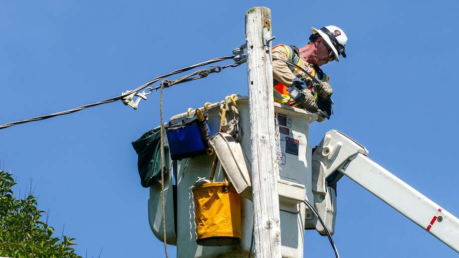 PG&E lineman, Vic Torino pull lines as a part of the routine repairs along Hall Road, Wednesday May 29, in Santa Rosa, CA. Photo: Lacy Atkins / The Chronicle