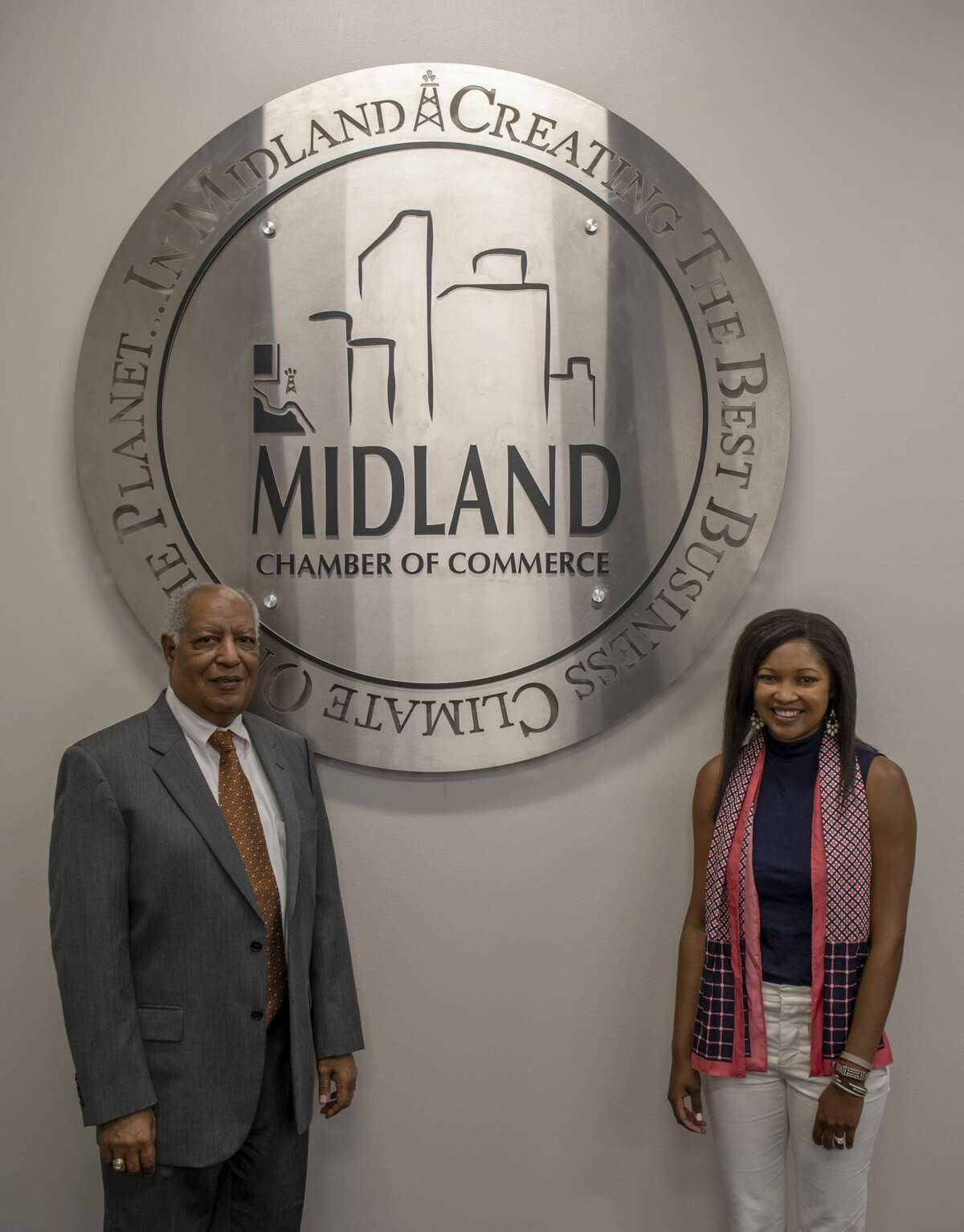 Father Larry Lawrence and daughter Jessica Rule pose for a photo June 5, 2019 at the Midland Chamber of Commerce. Jacy Lewis/Reporter-Telegram